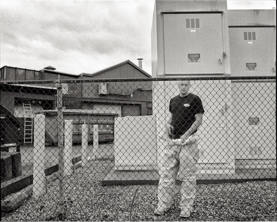 A worker outside the former Oak-Mitsui plant, a suspected source of contamination.